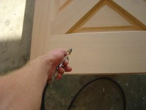 cleaning the dust from a fresh sanded new door