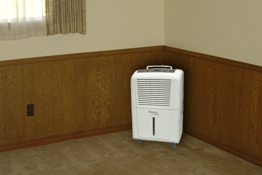 dehumidifier in the corner of the room