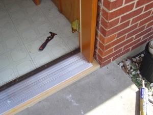 New threshold in place for new door installation