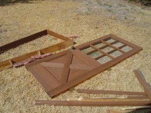old exterior door laying in the grass