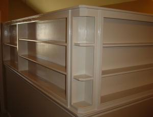 finished bookshelf on top of a half wall