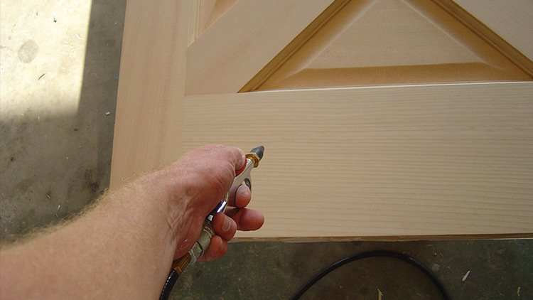 removing dust from your new door before staining it.