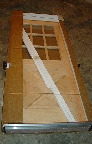 prehung wooden door still in shipping packaging